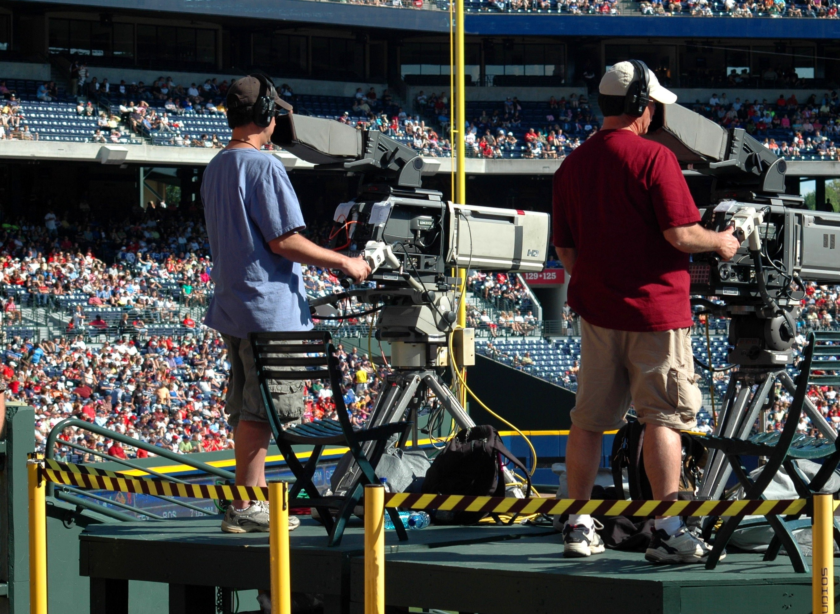 Camera people taking video at a sporting venue